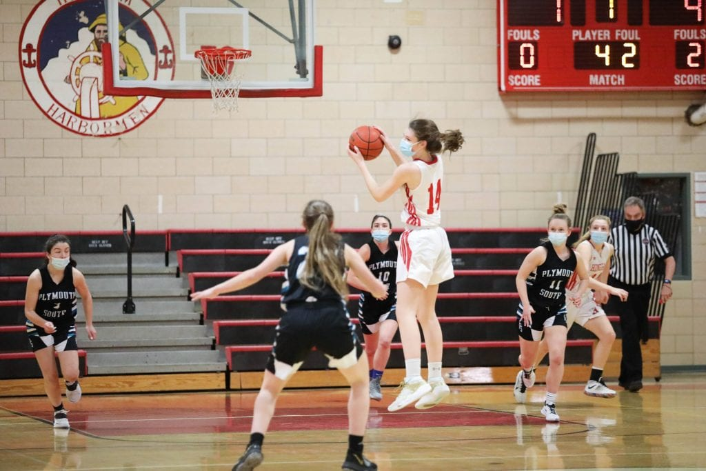 Junior captain Caroline Connelly grabs a rebound.
