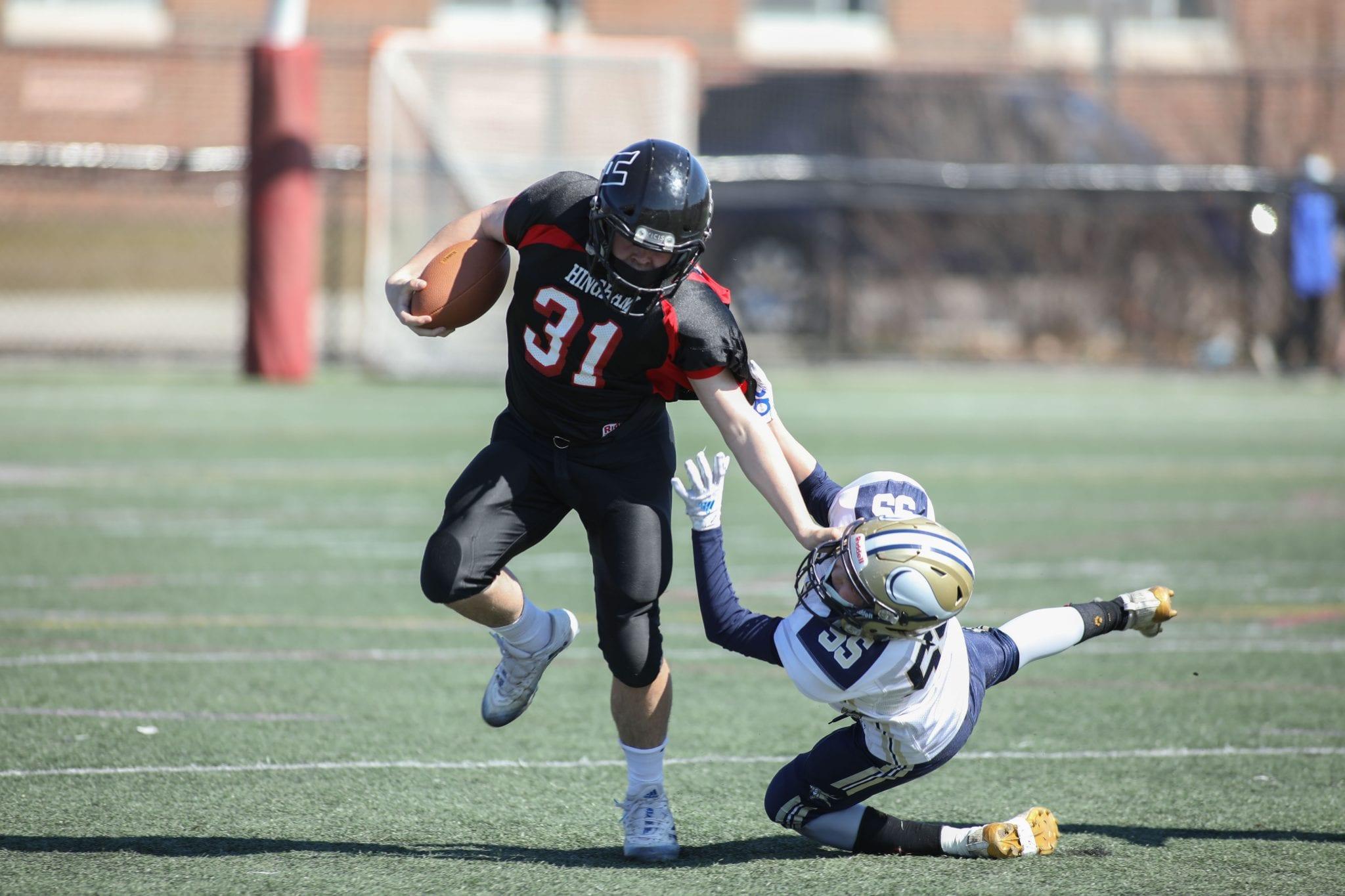 Mason Lennon stiff arms an East Bridgewater tackler.