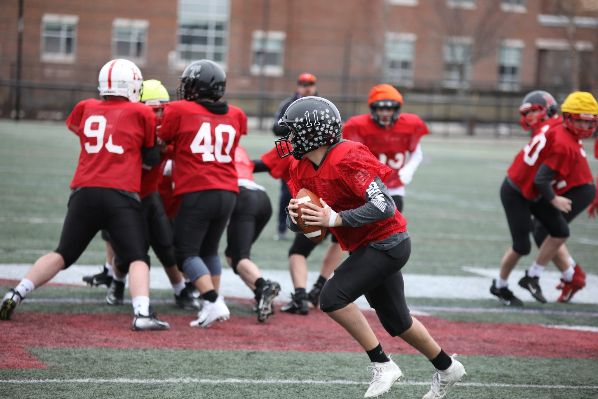 Starting QB Jake Varholak rolls out of the pocket during practice last week.