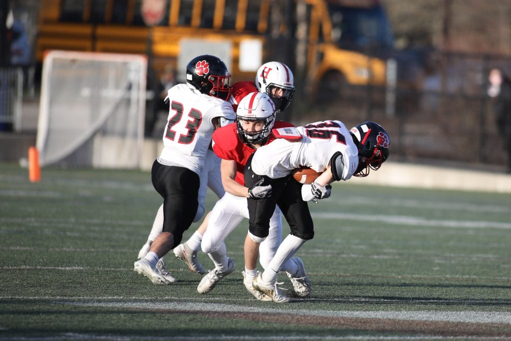 Sophomore Anthony Fabrizio wraps up the punt returner for no gain.