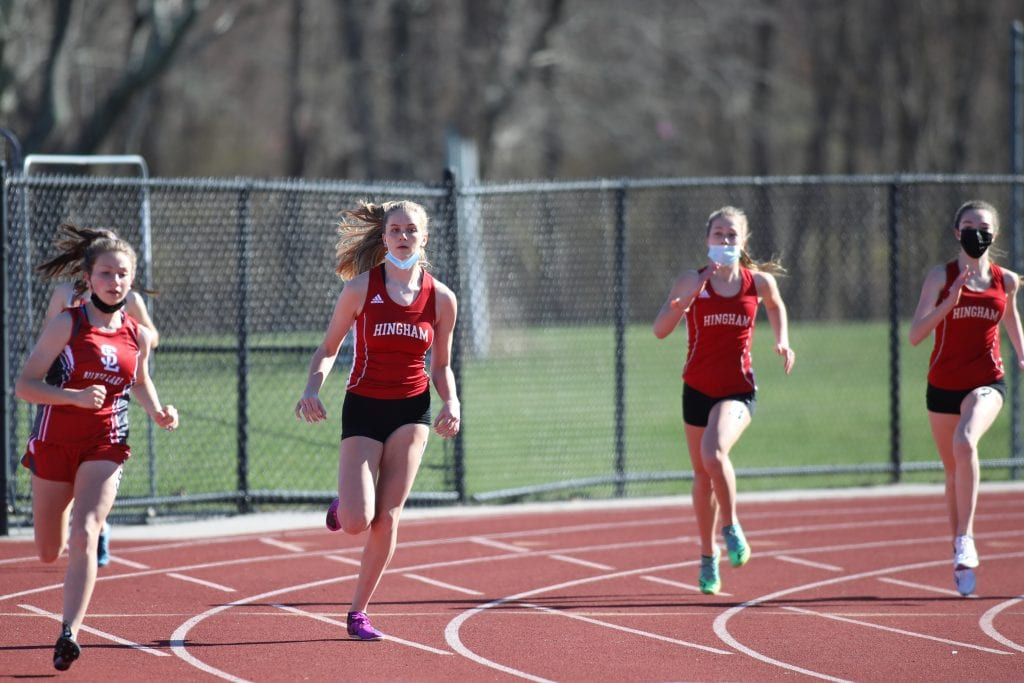 Junior Maureen Koenen (left) squeeked out a victory over sophomore Margaret Lowther in the 600m.