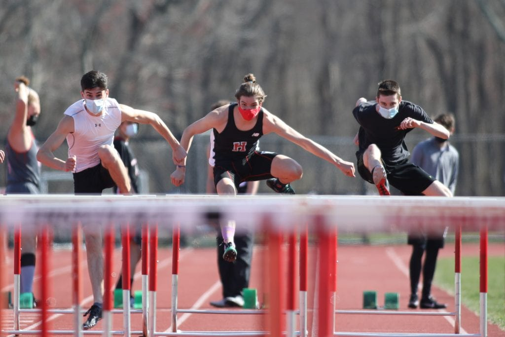 Senior Brian Fennelly (left) takes home first and junior Thomas Shetzline (center) comes in second in the 55m hurdles.
