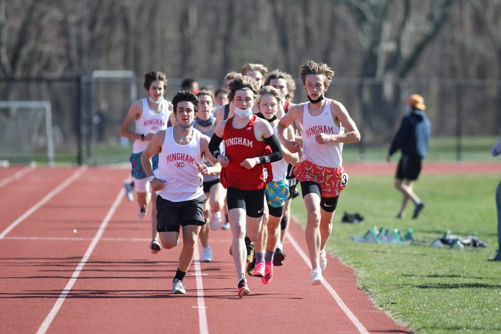 Hingham dominated the mile grabbing the first four places - senior Kevin Ierardi (right), junior Matt Hall (second on left), junior Steve McDougall (left), & junior Leo Burm (second on right).