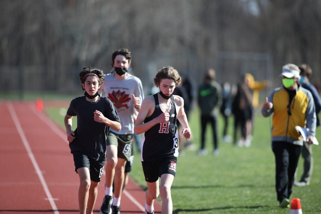 Freshman Brendan Burm (right), sophomore Michael Renna (left), and freshman Charile Matthews (back) had a strong showing in the 2 mile.