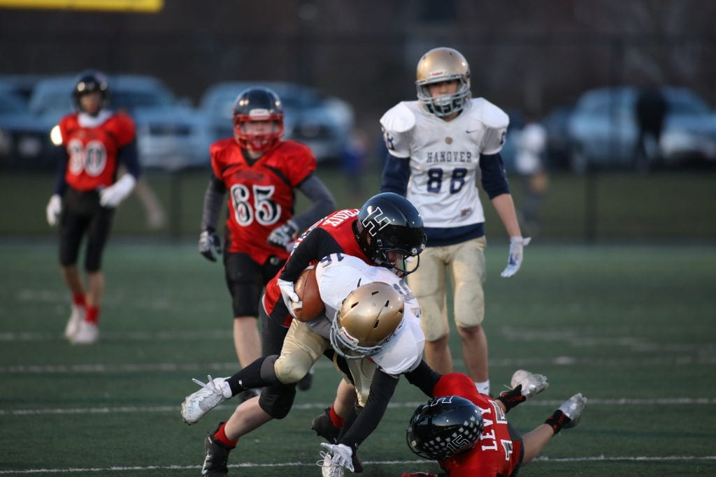 Ryan St. Croix and Alex Levy make the tackle.