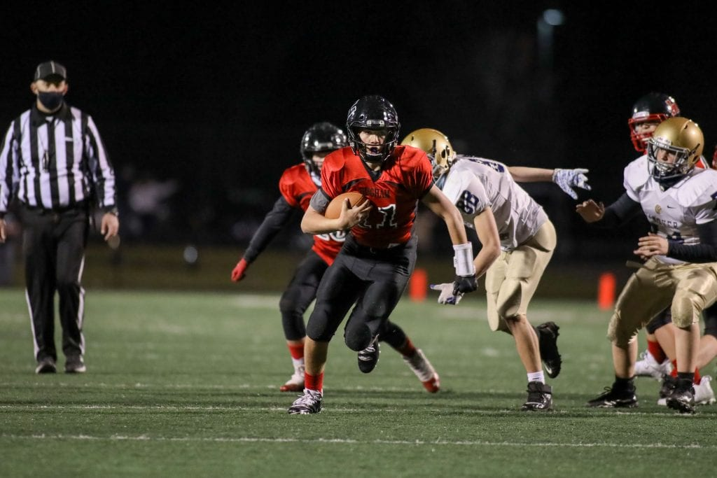 QB Jake Varhorlak keeps the ball and runs for the first down.