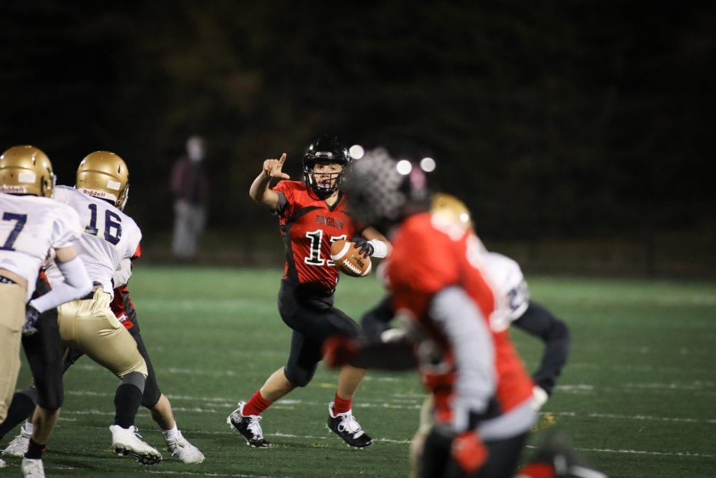 Jake Varhorlak points to his recieve to go deep as he sets up to pass the ball.
