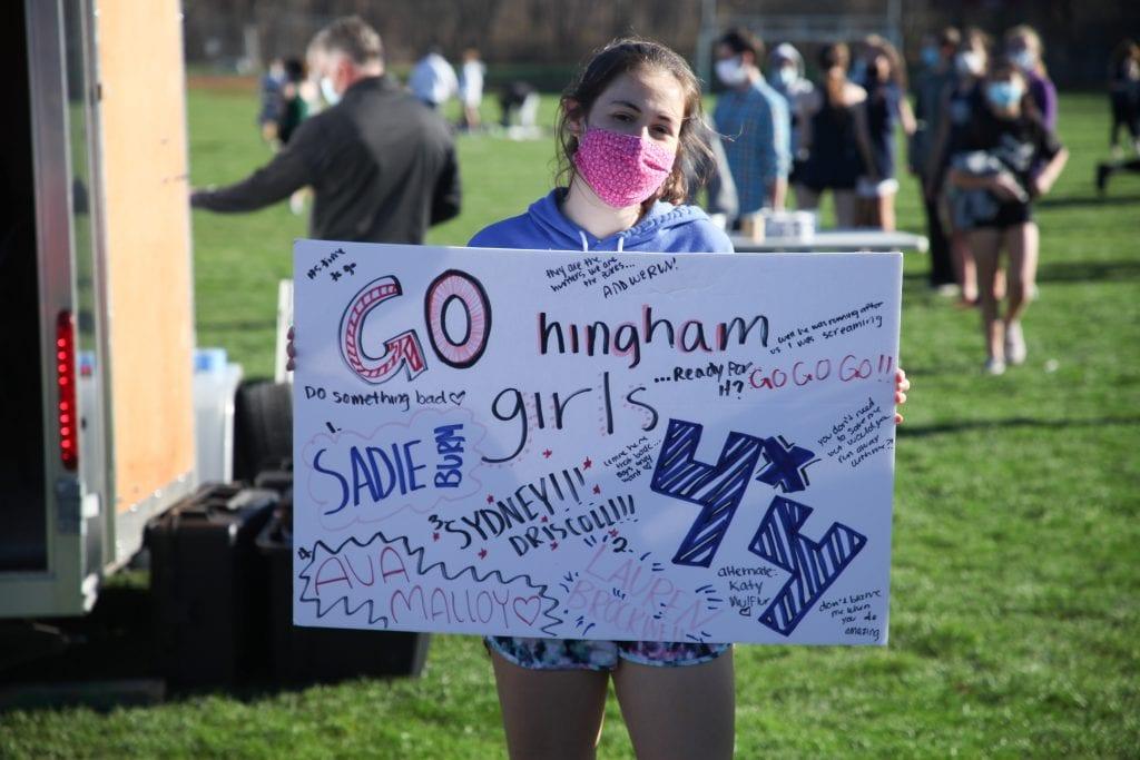 Junior Elle Cavanaugh cheering on her team.