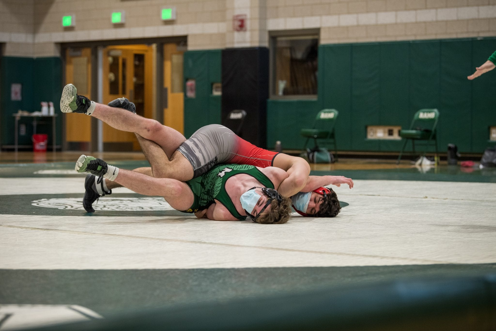 Senior captain Joe Wiley (170) attempting to pin his opponent.  (Photo by Fotique.)