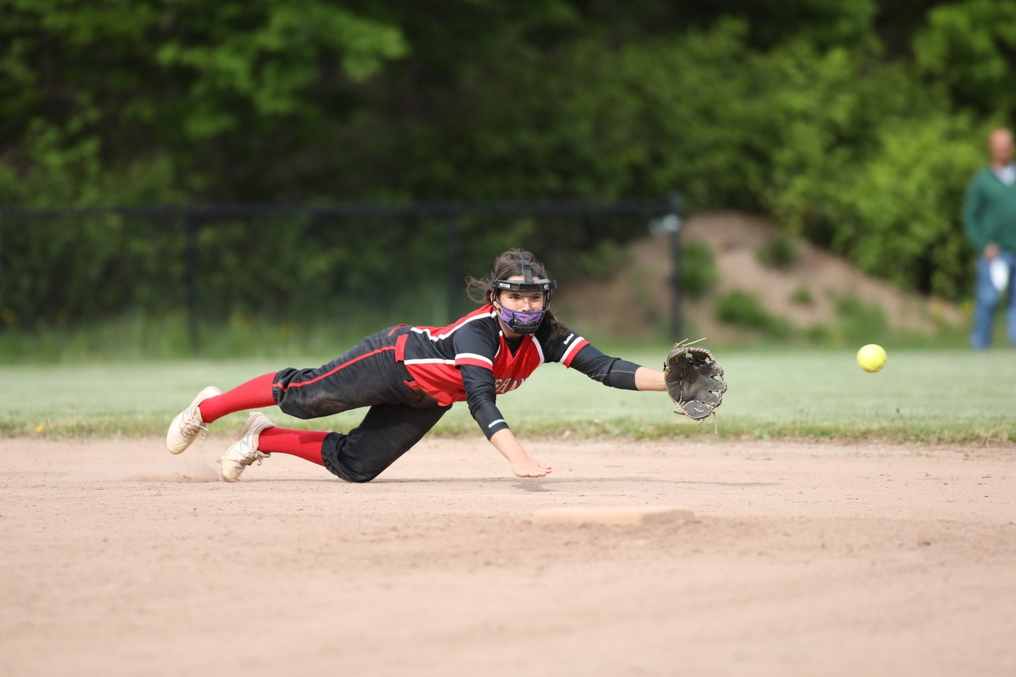 Sophomore Bella Sullivan makes a diving attempt to catch the ball.