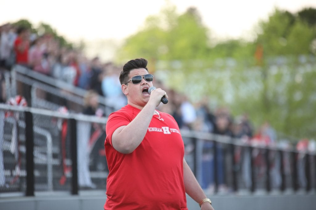 HHS Alum Nick Capodilupo returned to sing the national anthem.