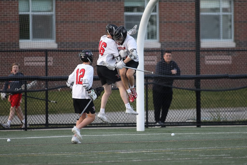 Sophomore Charlie Packard (16) celebrates after he scores Hingham's first goal of the game.