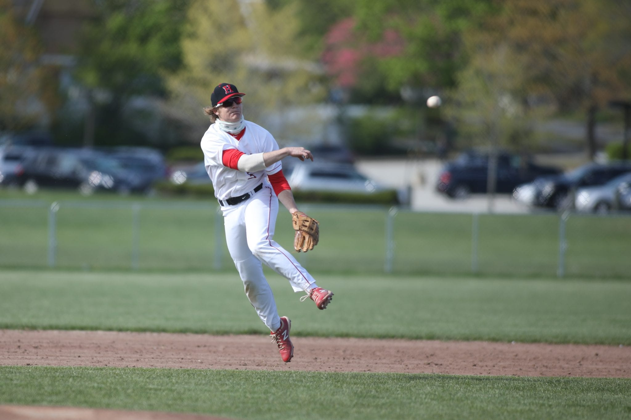 Senior captain Andrew McGowan fires it over to first base early in the game.