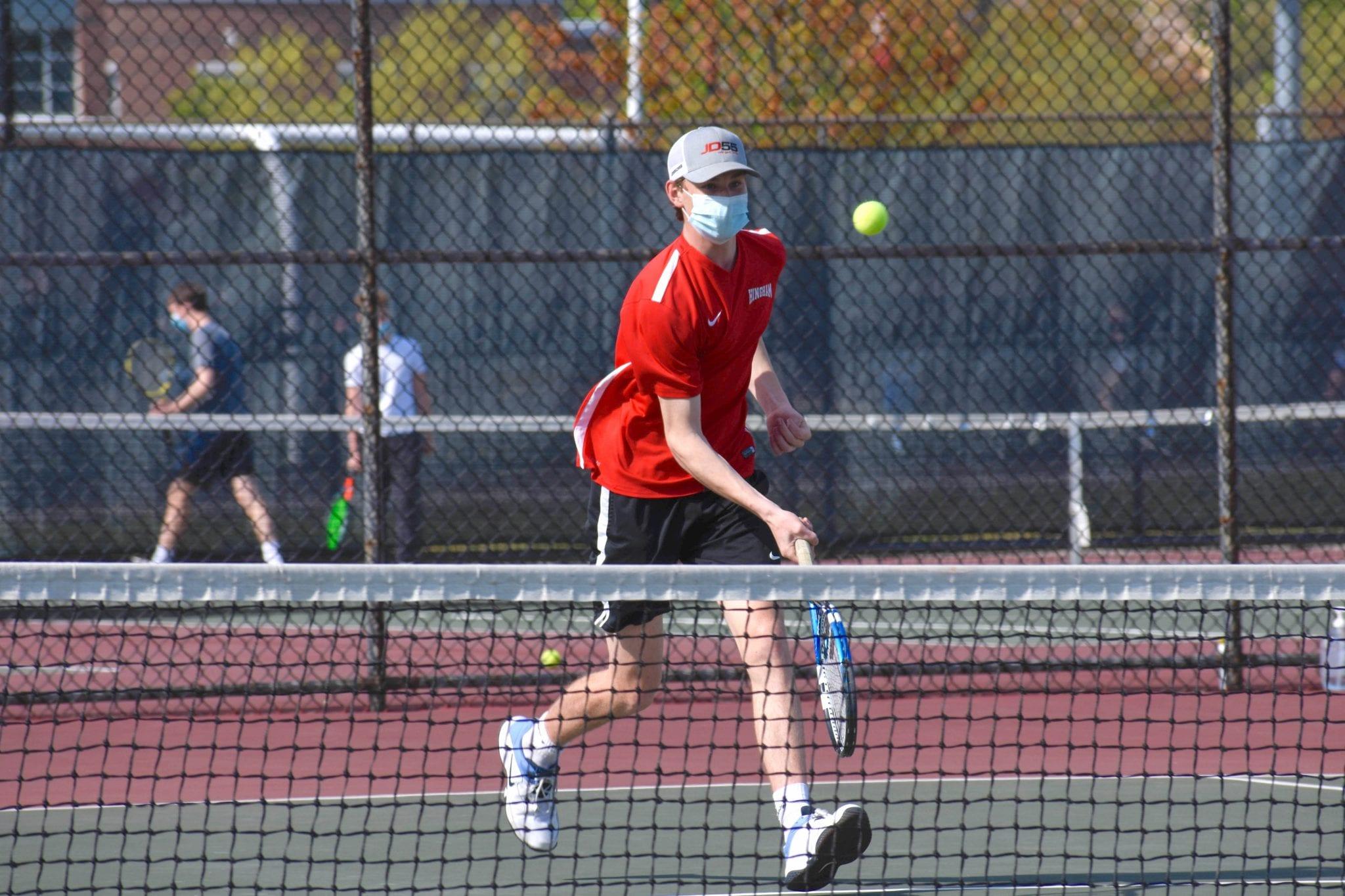Sophomore Charlie Even meets a volley at the net. (Photo credit: Jake Bednarski)