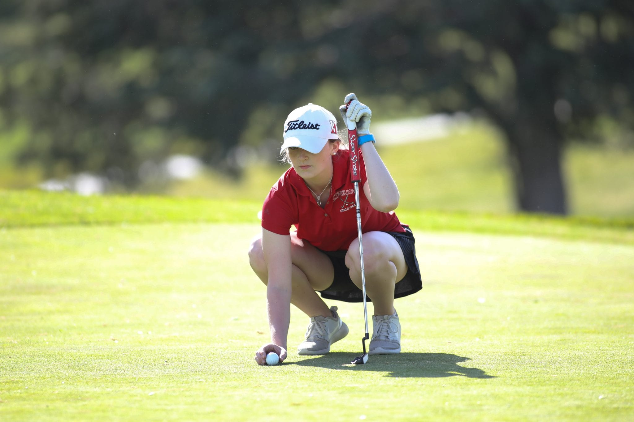 Junior Niamh McGuinness lines up her putt on the first green.