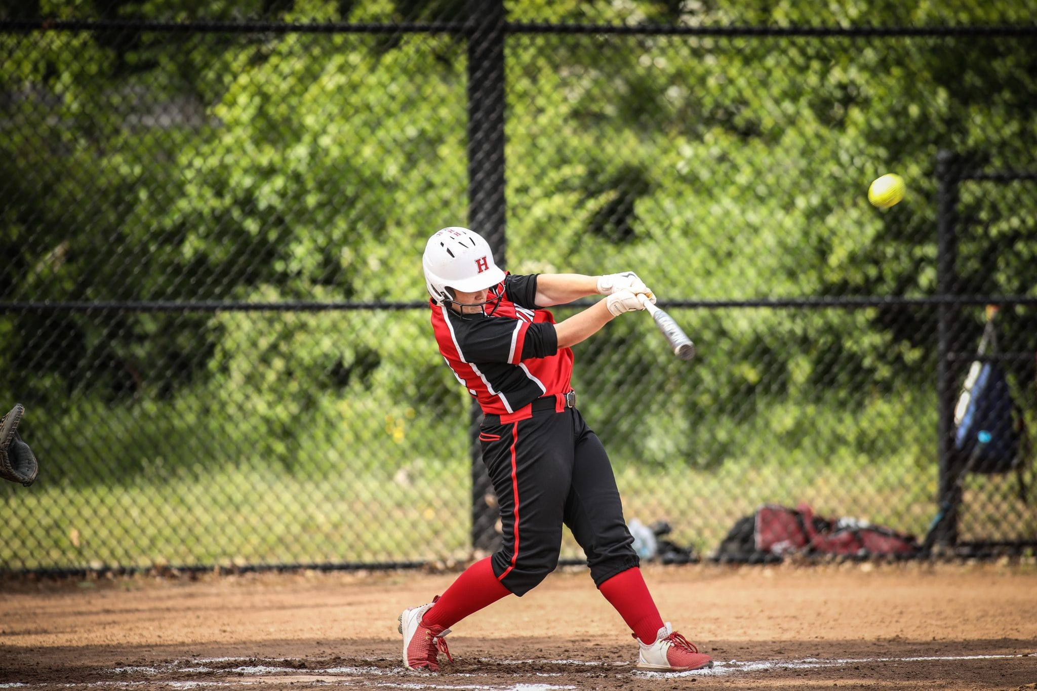 Sophomore Sarah Holler launched this pitch over the centerfield fence for what is believed to be the first grand slam in HHS softball history.