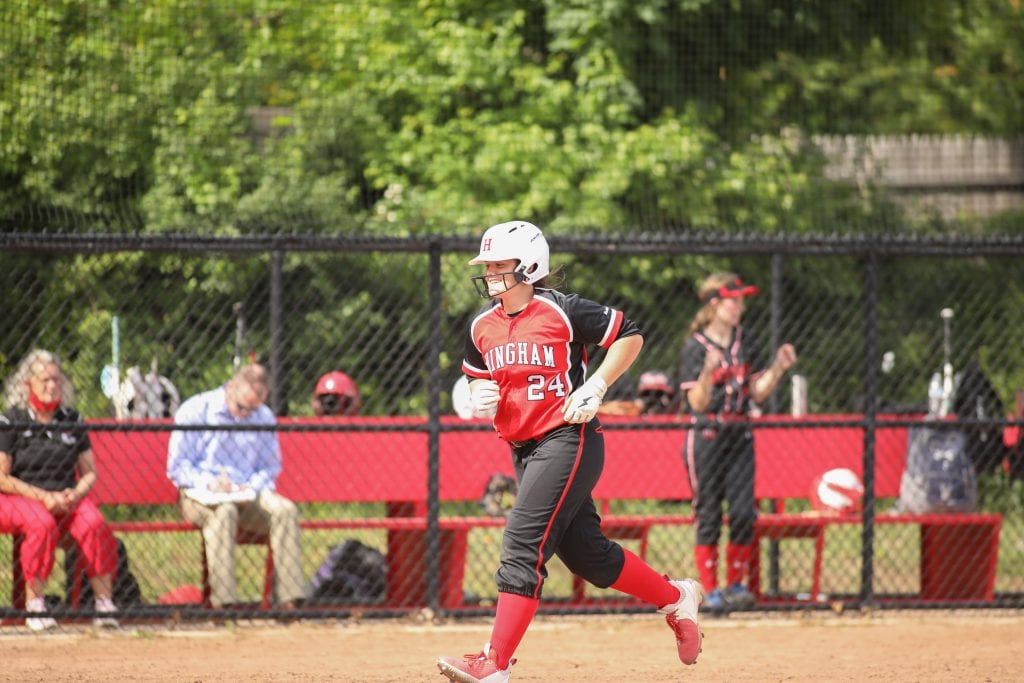 Sophomre Sarah Holler happily jogs around the bases after her grand slam.