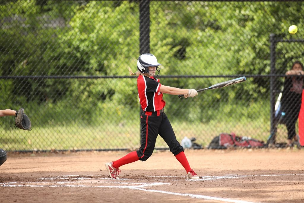Sophomore Aisling Doyle makes good contact with the ball for one of her 2 hits in the game.