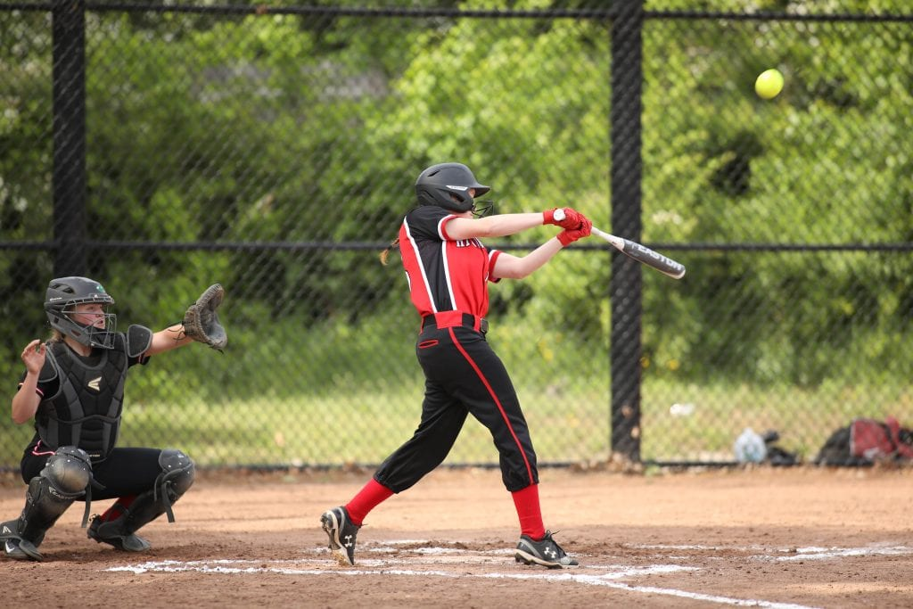 Junior Madison Alyward punches one into the outfield for a base hit.