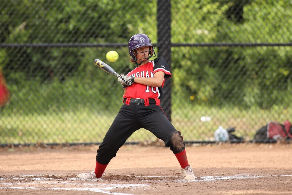 Junior Halle Morton backs away from an inside pitch.