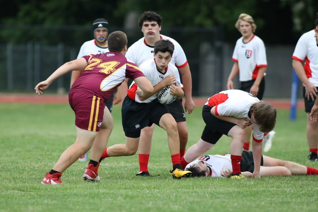 Sophomore Liam Burns keeps the ball himself out of the scrum.