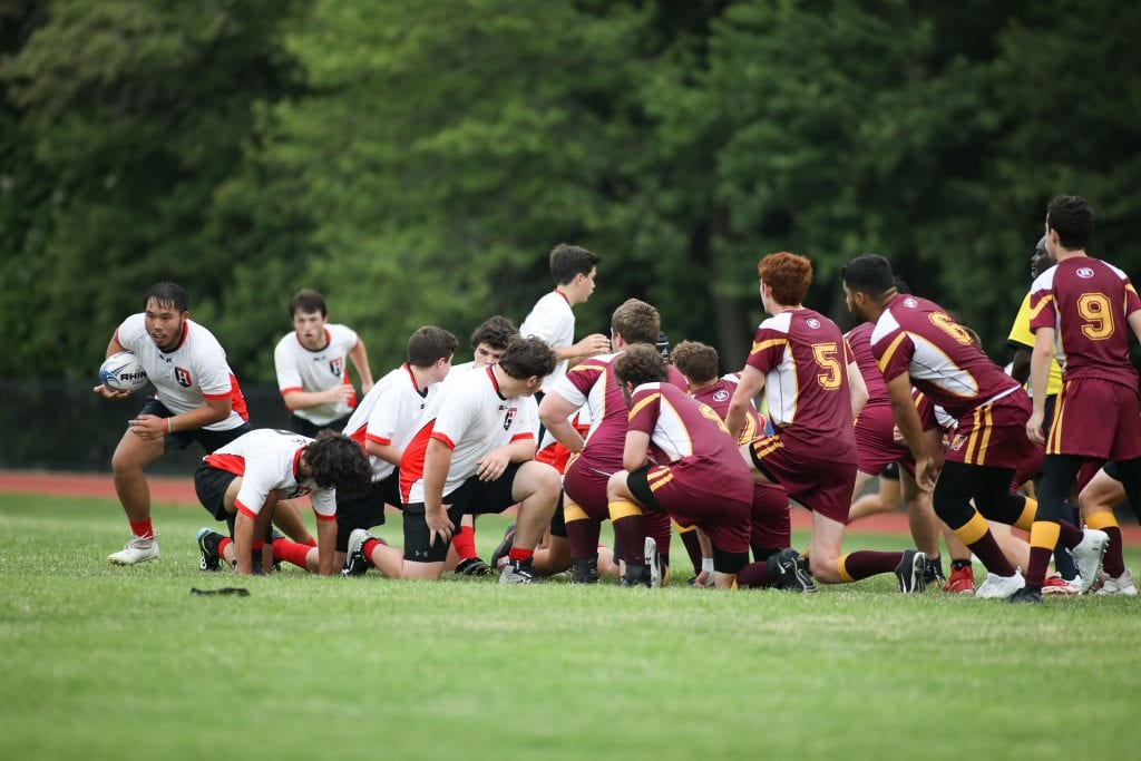Senior captain Liam Collins sneaks out off the edge of teh scrum.