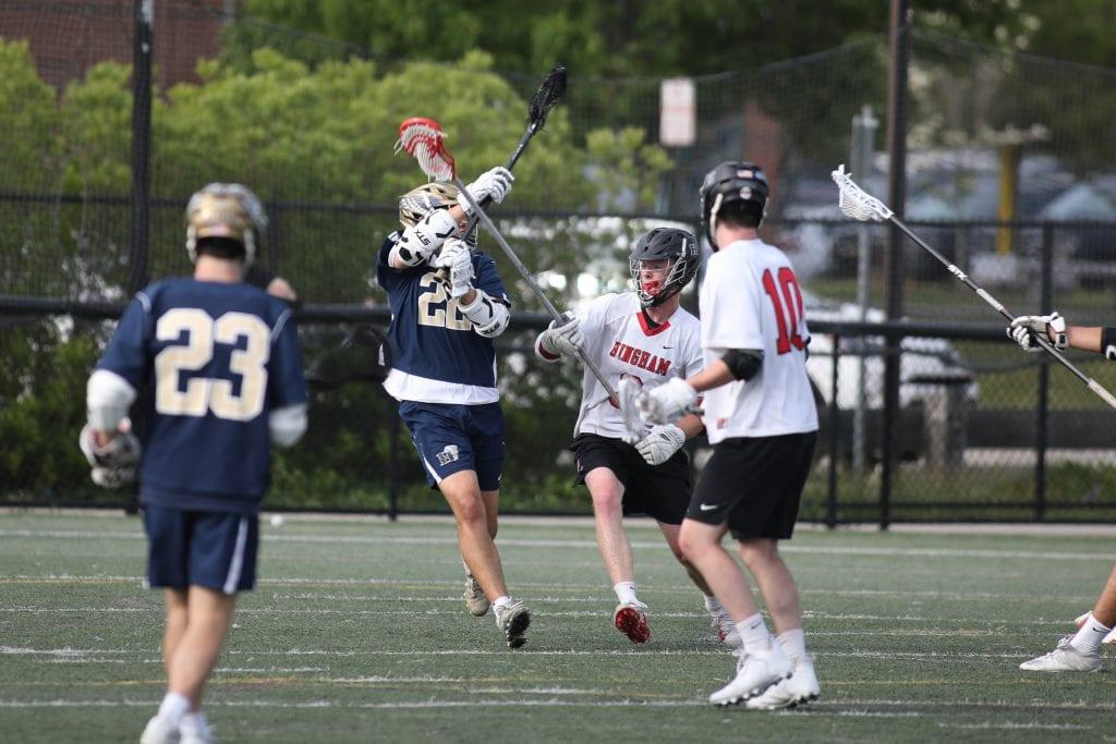 Senior Charlie Noering breaks up a pass.