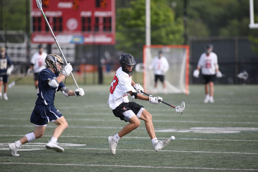 Junior captain John Sula chases down a loose ball.