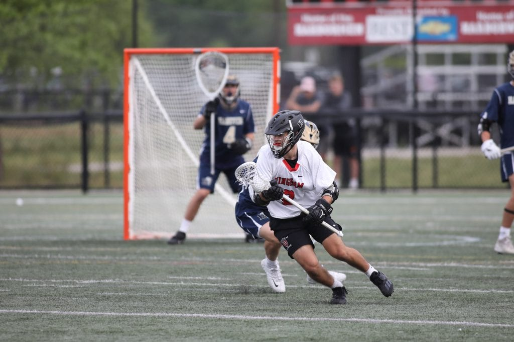 Junior Cian Nicholas fights off the defender before scoring.