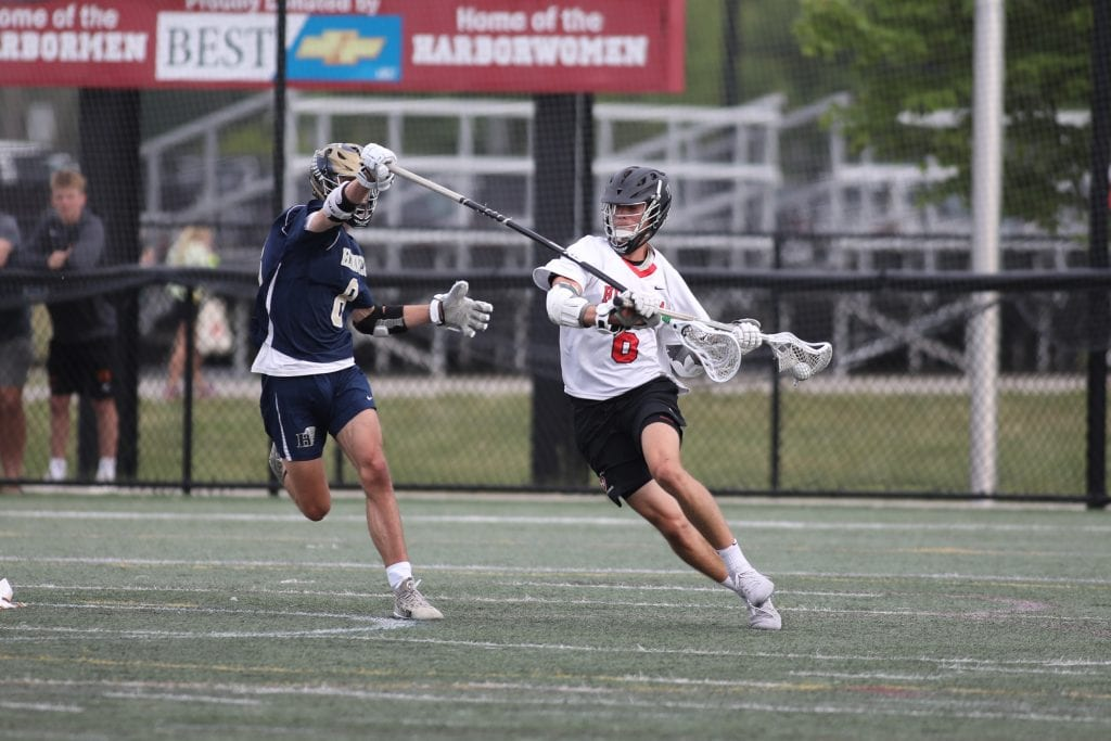 Senior captain Paul Forbes withstands a little stick checking late in the game.