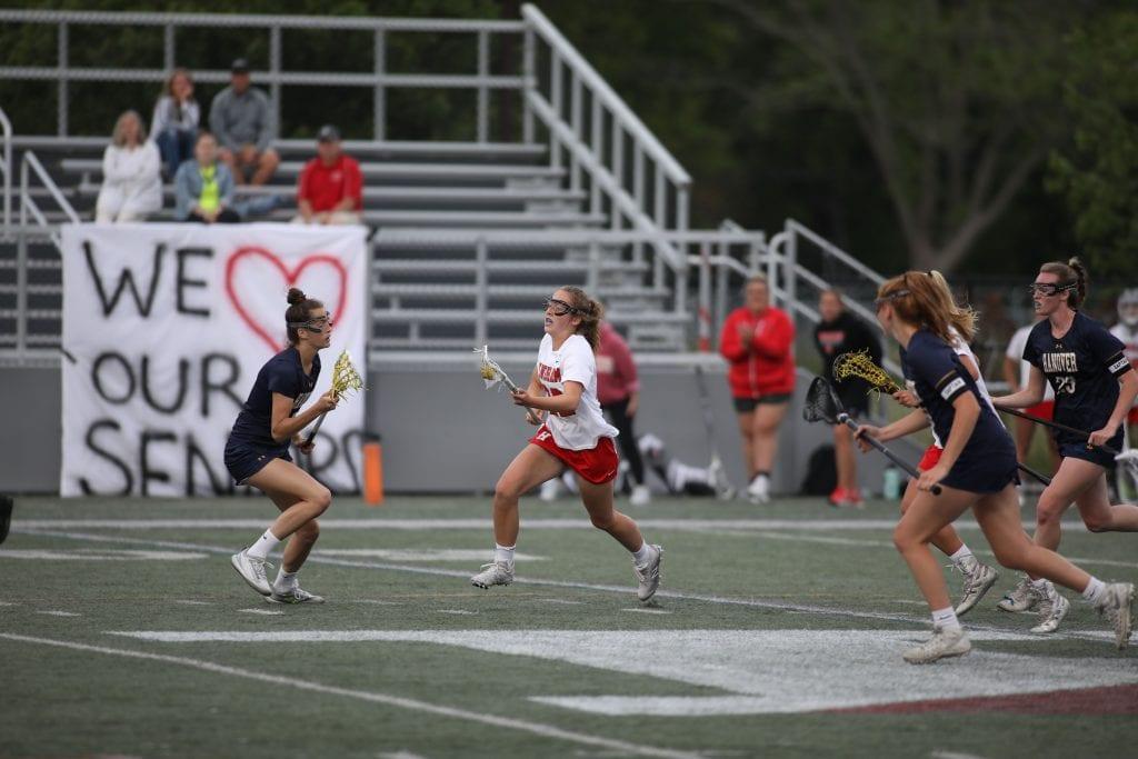 Junior Ellie Fabbro splits the defenders as she advances the ball.