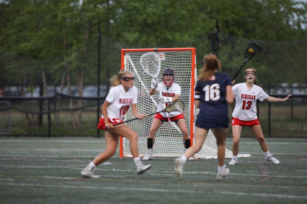 Junior goalie Olivia Cataldo lines up to make the save.