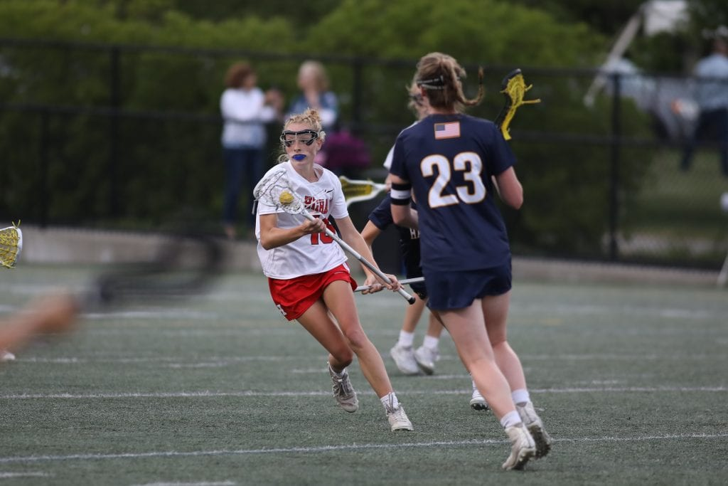 Junior Kyle Wilson cuts across the field before scoring one of her 4 goals.