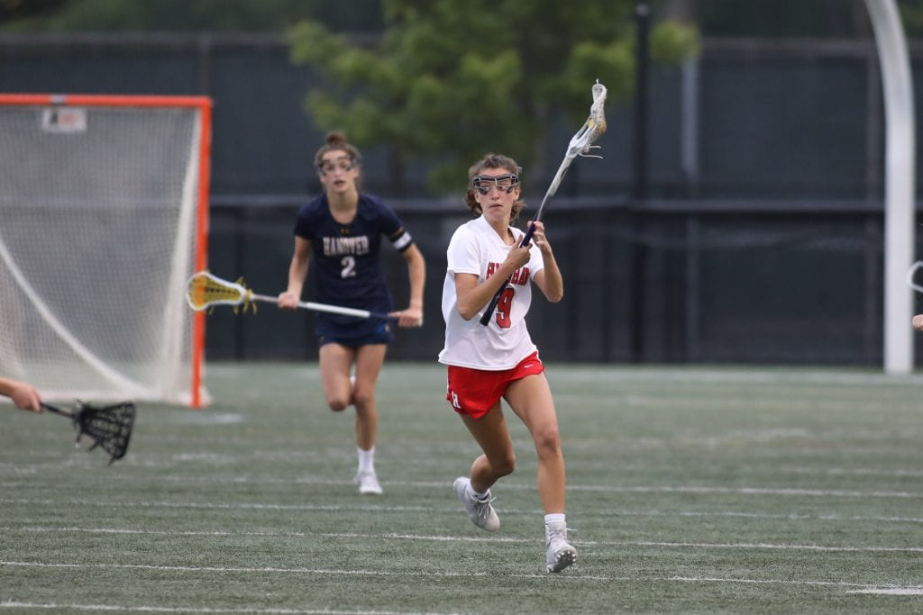 Senior captain Callie Daly eyes the field for an open teammate.