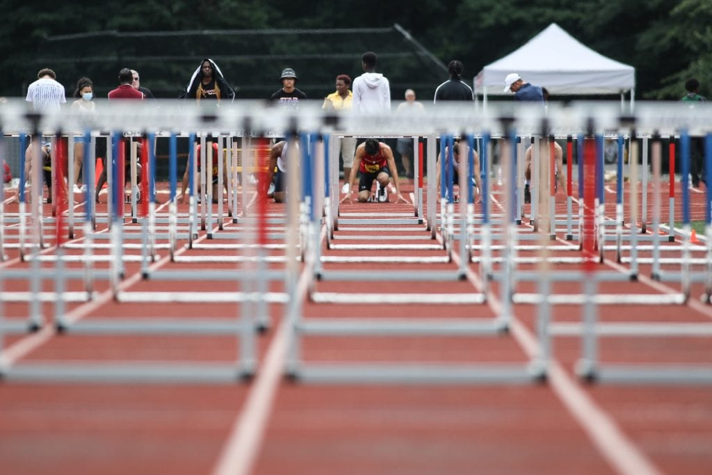 Senior captain Brian Fennelly gets set for the 110m hurdle finals.