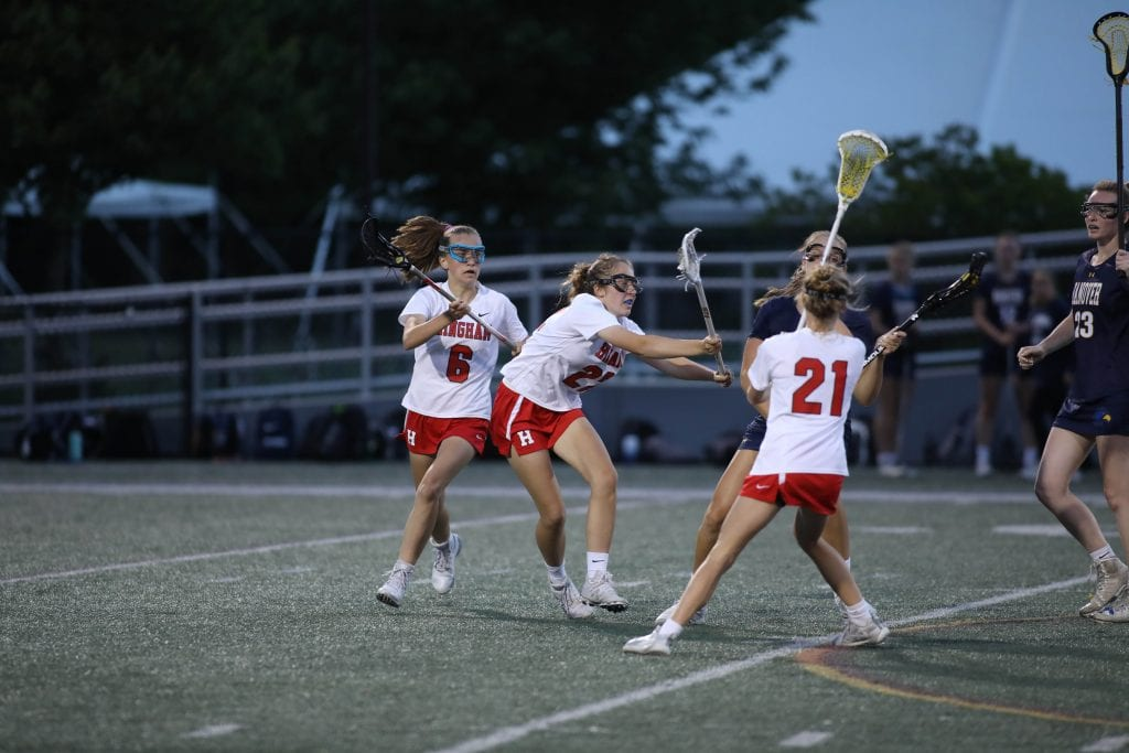 A number of Harborwomen swarm the ball late in the game.