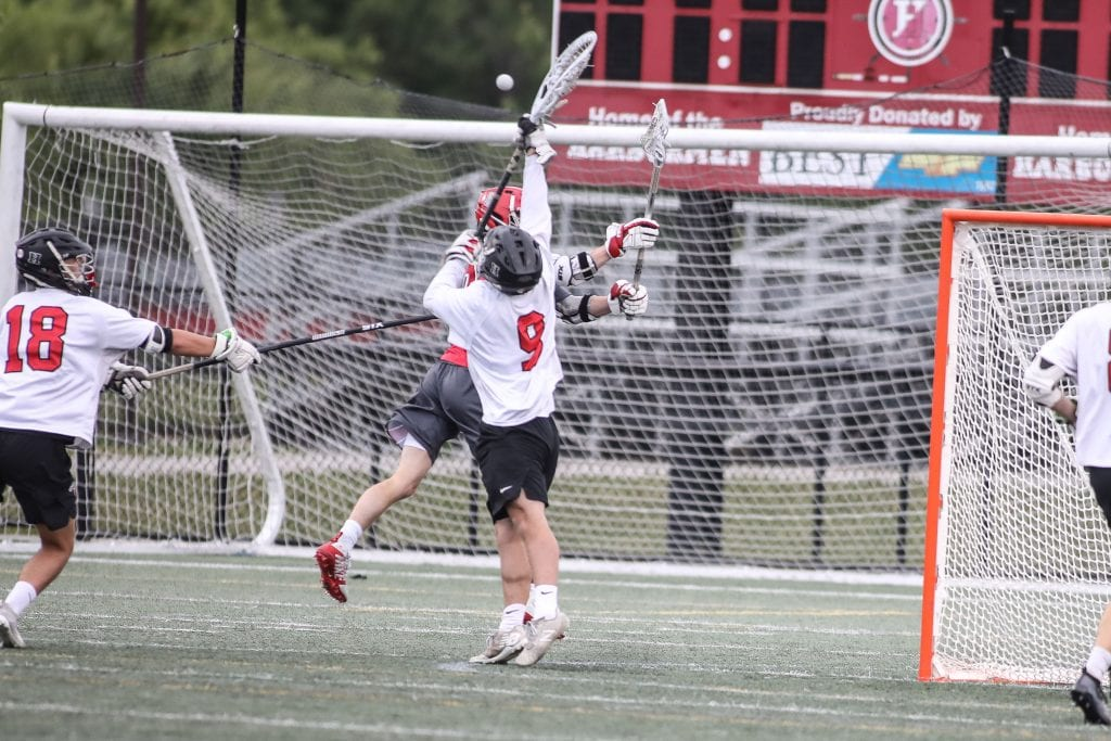 Senior captain Sam Bellomy comes out of his net to make a big stop in the first half.