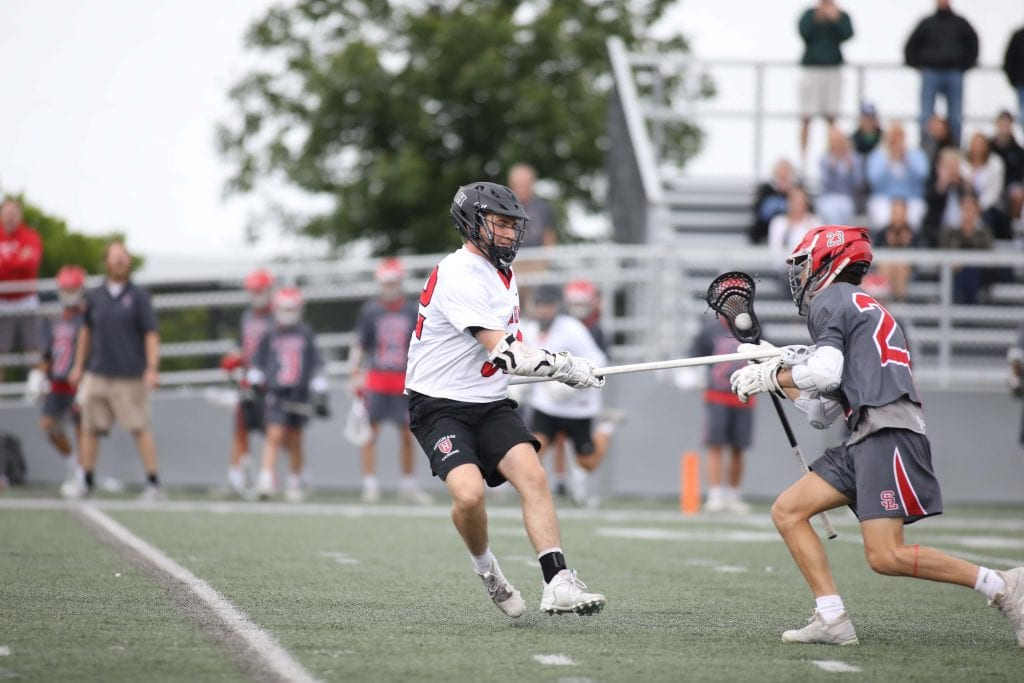 Sophomore Ben Rakauskas gets a stick on the SL player.