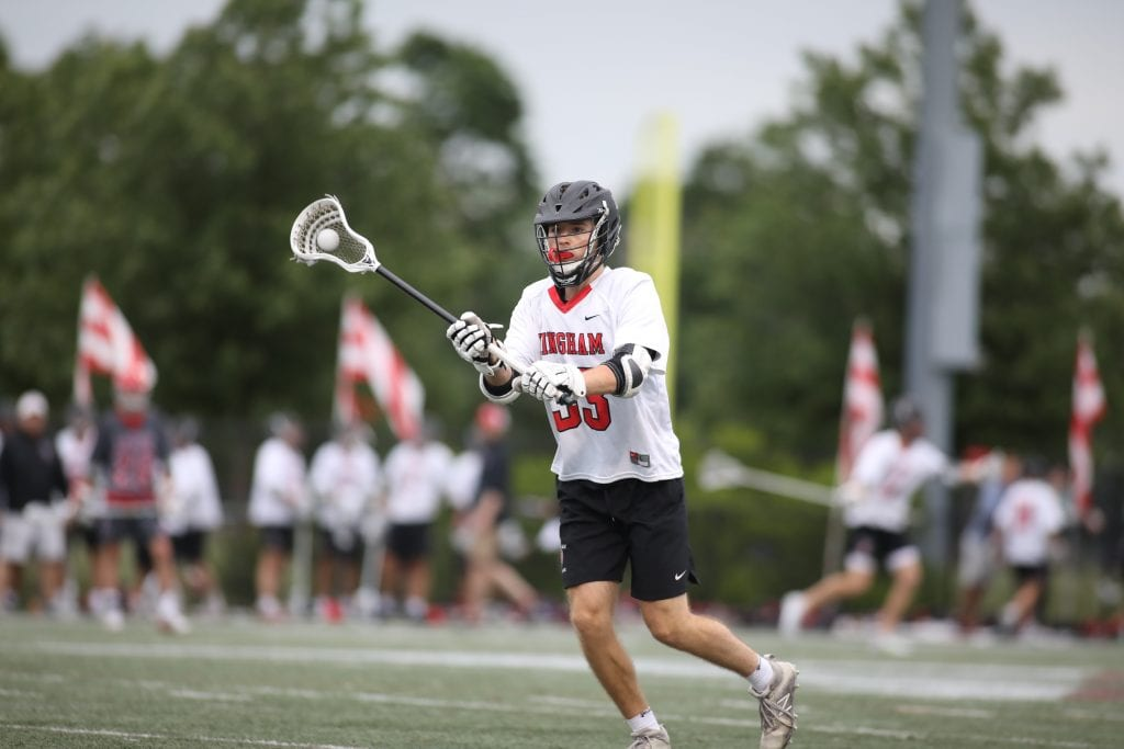 Senior Jake Sutton passing the ball around as time expires in Hingham's win.