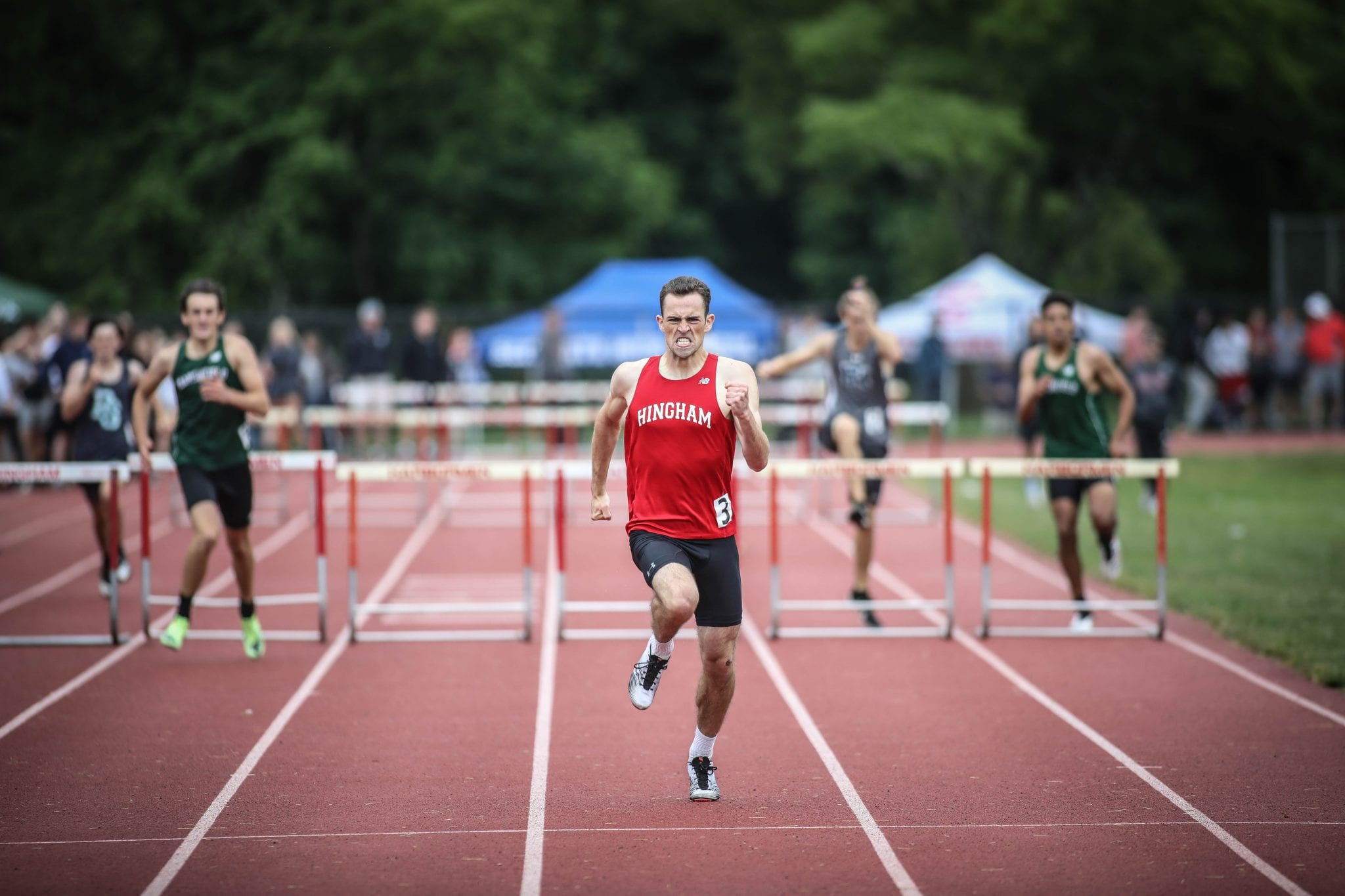 Senior captain Sean McKay pulls away from the field in the 400m hurdles.