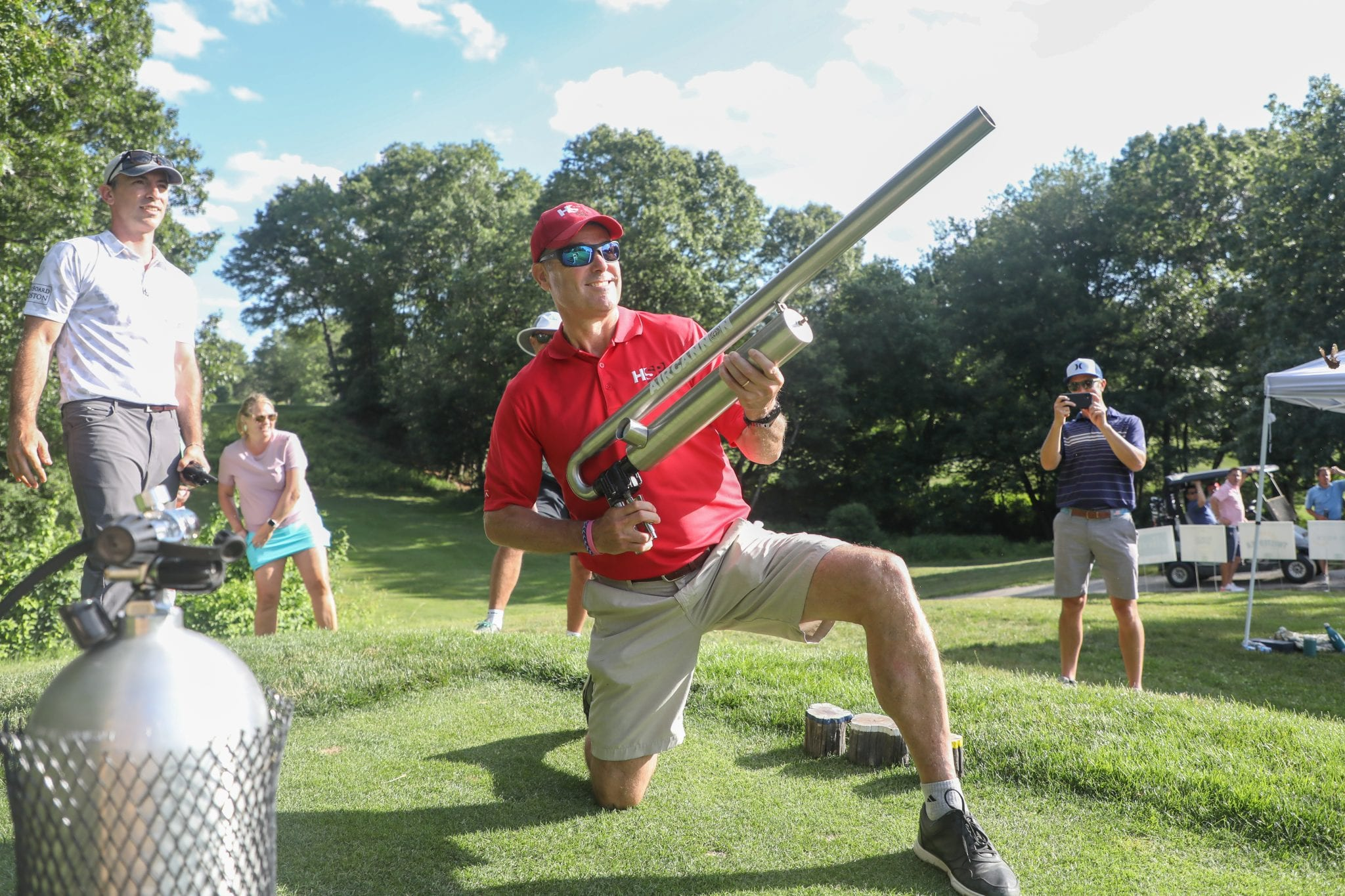Former HSP President Fred Hussey fires his golf ball from the air cannon on the 16th hole.