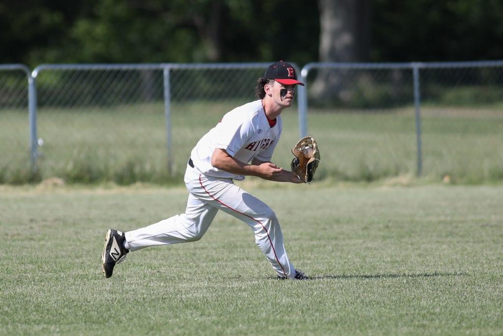 Senior Matt Lahiff runs to make the out in left field.
