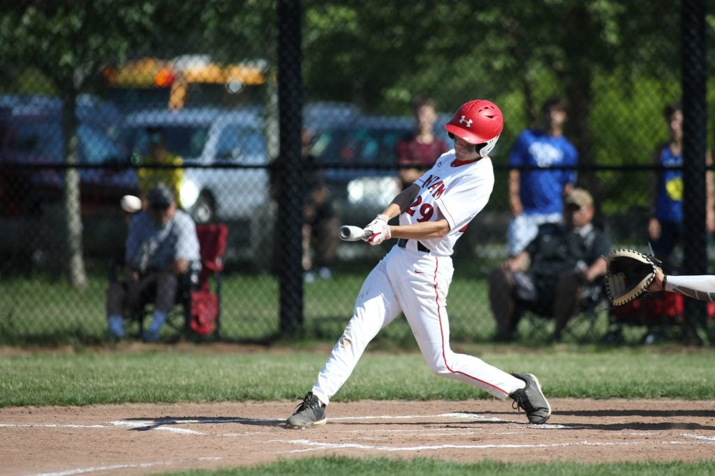 Senior Connor Stanley with a hit in the first inning.