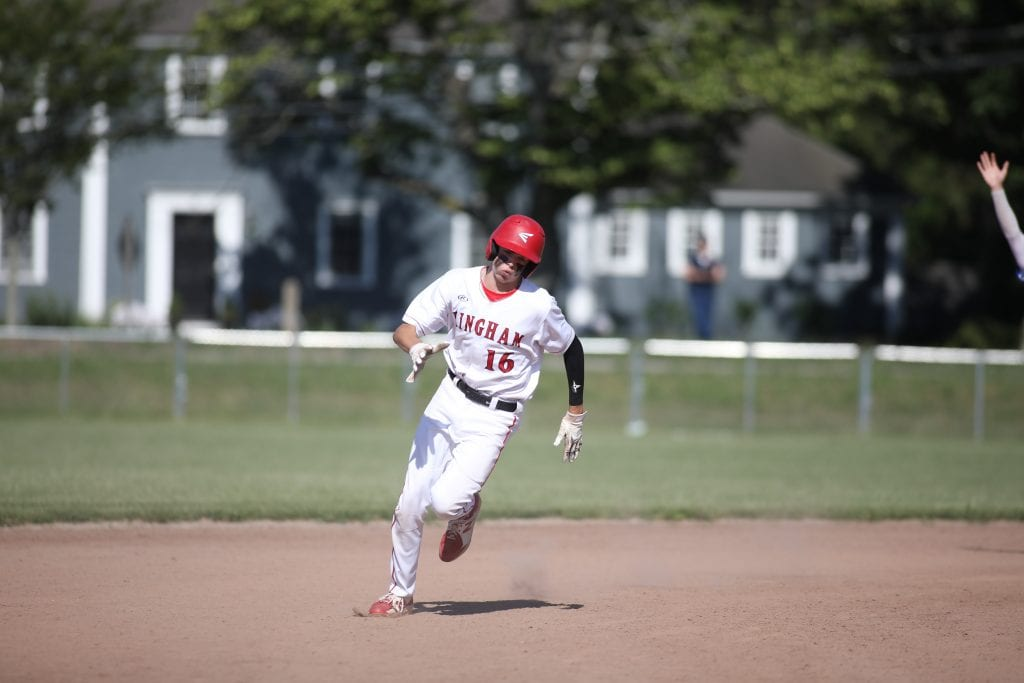 Junior Bobby Falvey rounds second on a base hit.