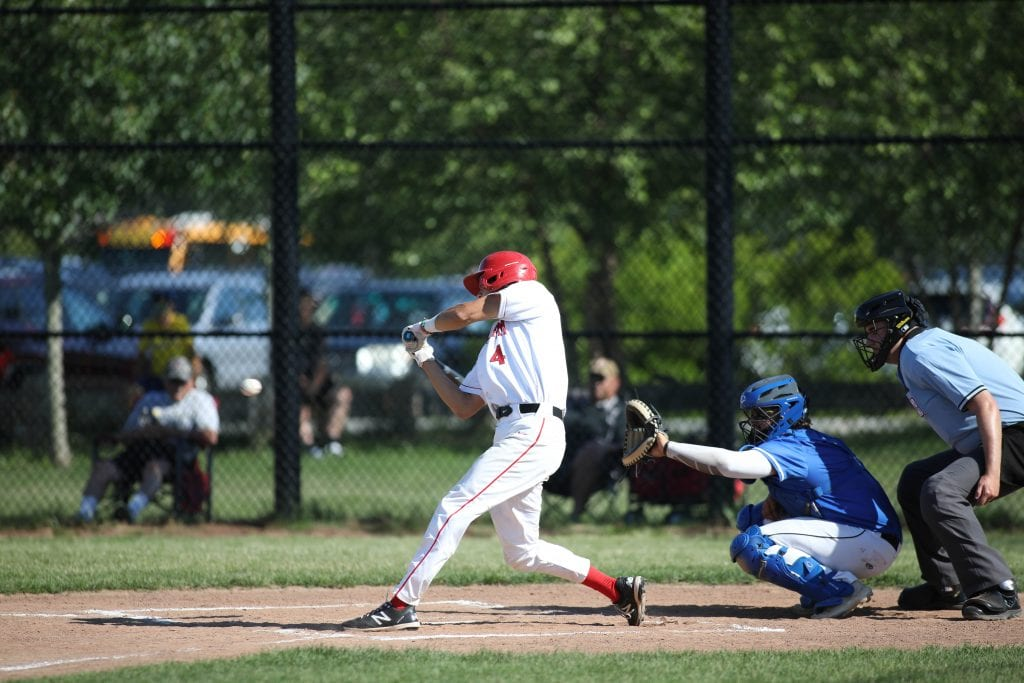 Senior Oliver Fortin belts a hit in the early innings.