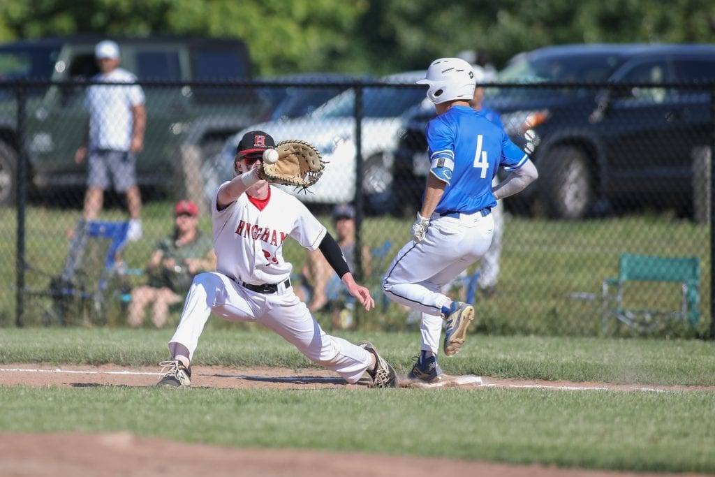 Senior Jacob Nolan stretches out, but the runner just beats the throw.