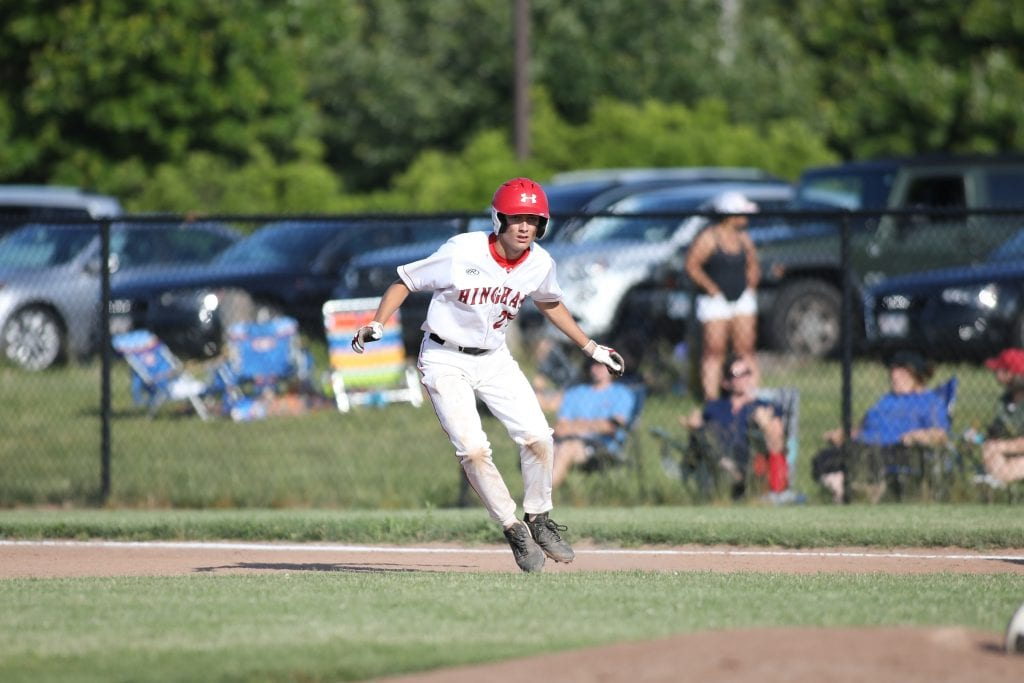 Senior Connor Stanley eyes the pitcher before stealing second base.