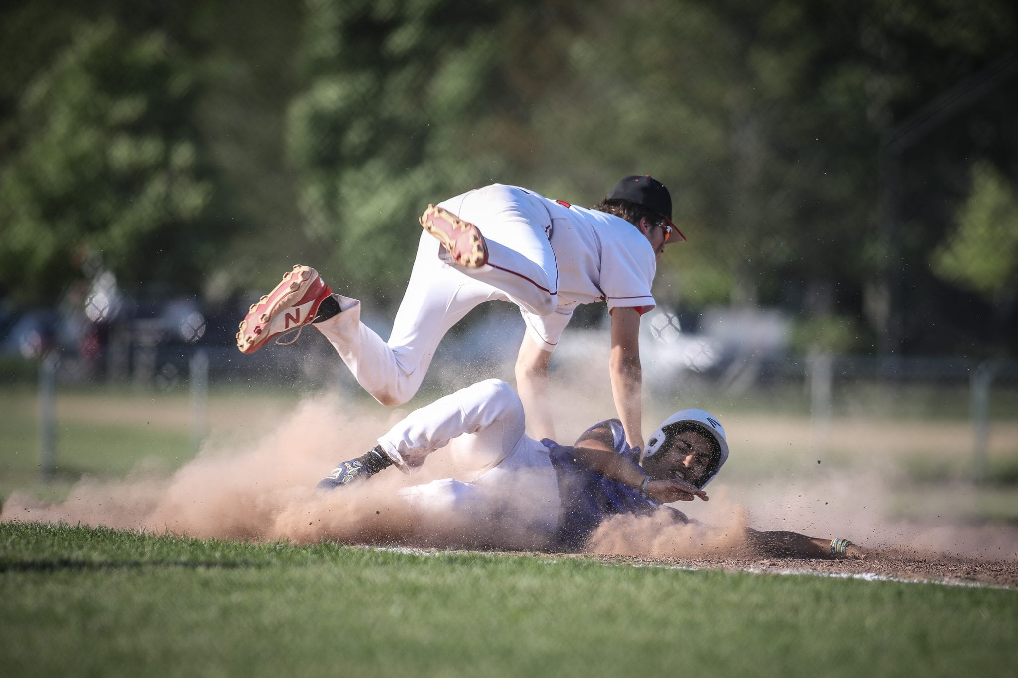 Junior Bobby Falvey avoids the collision after he tags out the runner trying to steal third.