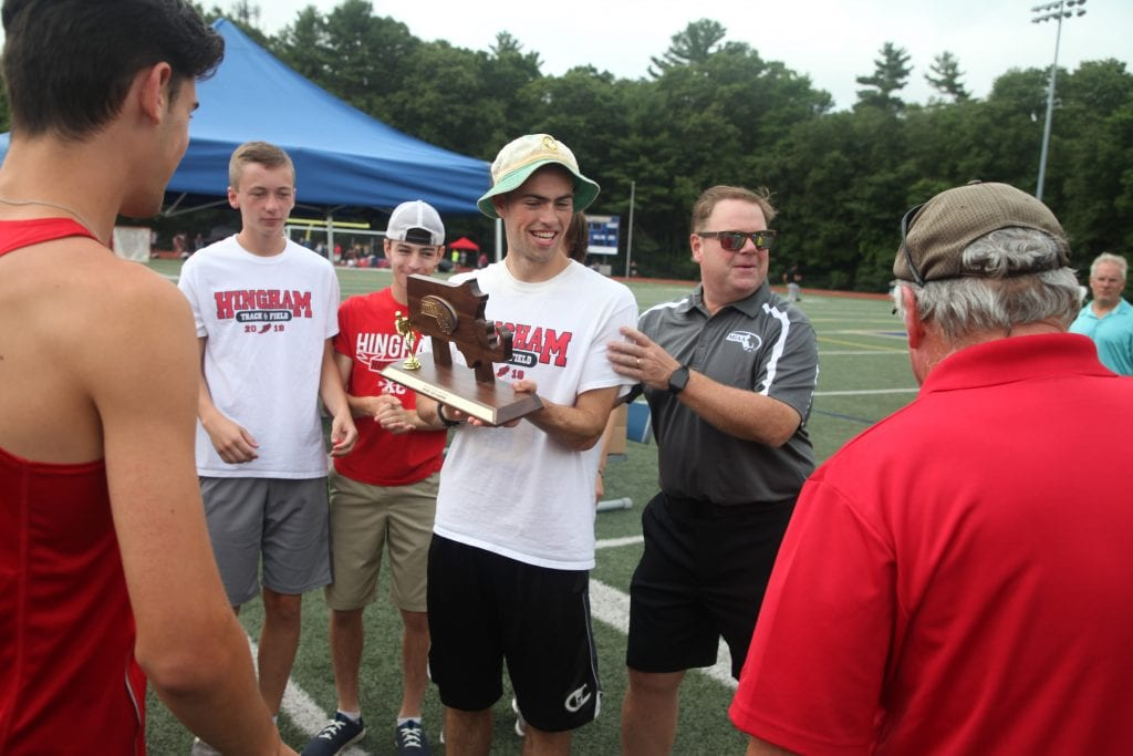 Senior captain Sean McKay receives the D1 South Sectional Title form the MIAA rep.
