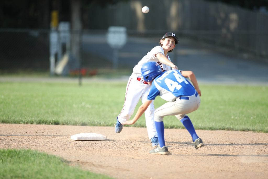 Cole Snowden attempts the double play in the first inning.